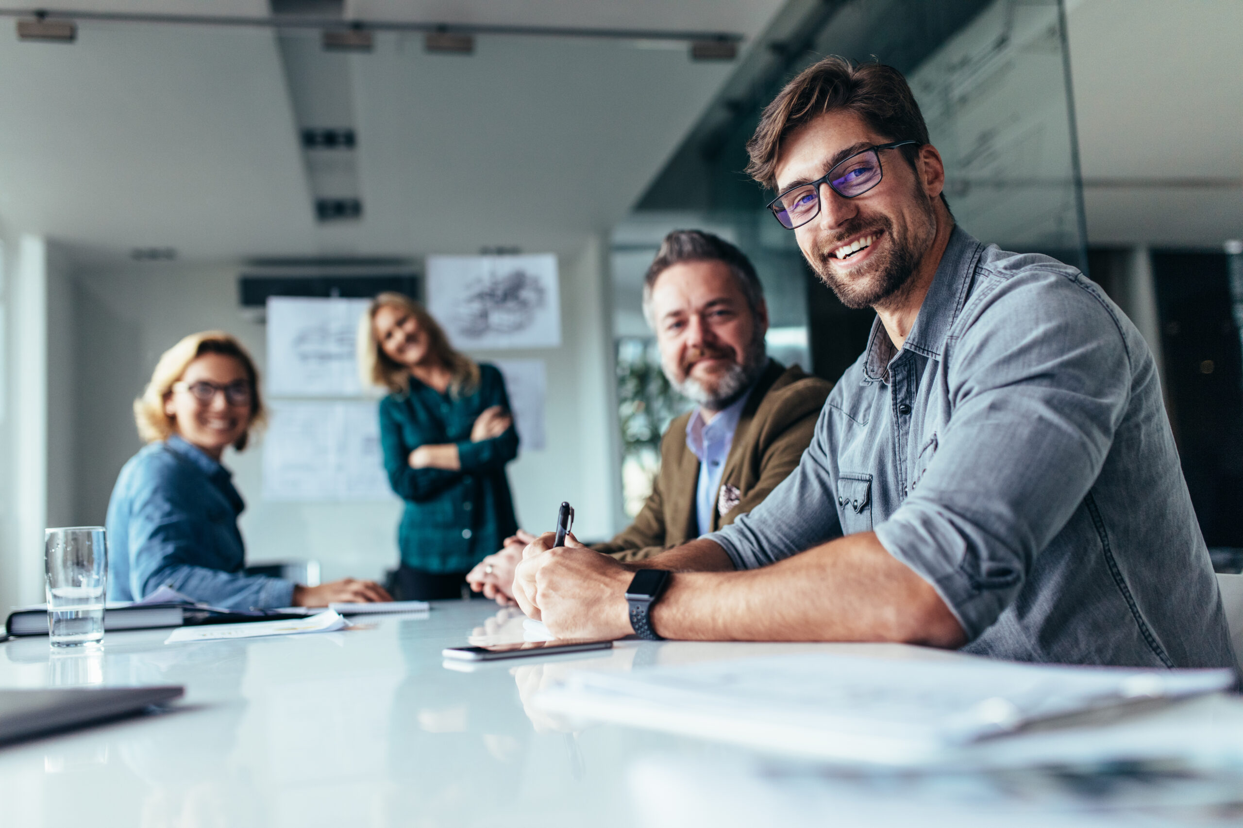 Happy group of businesspeople during presentation